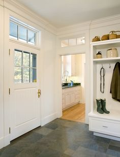 so many things I love about this entry way...the slate tiles, the windows above the door, the little room...
