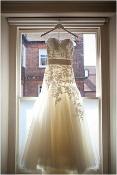 A beautiful way to photograph this wedding dress, lots of backlight,clearly see elegant printed lace skirt~  http://on.fb.me/IWoXAk