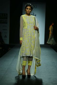 Dress by Vineet Bahl, a perfect modern look for a wedding event.