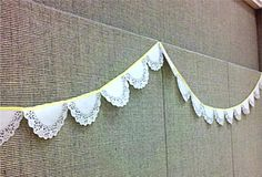 For the railing... spray painted silver on the edges.....Simple DIY Wedding Decor Doily Garland!