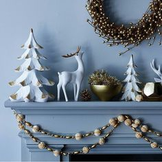 White and gold pieces bring this mantel together.