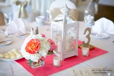 Wedding lantern centerpiece. Free Spirit Roses. White Hydrangea. Sparkly gold table number. Gold and coral wedding.