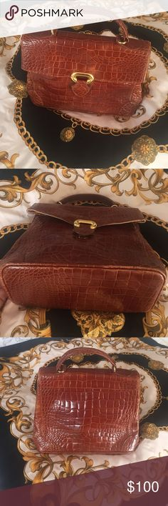 Vintage Furla 1950's bag Lovely vintage handbag. FURLA made in Italy. Leather. No sever scratches. No stains on the exterior but some on the interior. Some wear on the bottom. Furla Bags Totes