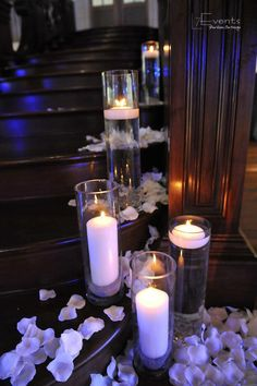 the staircase adorned with candles and thousands of rose petals