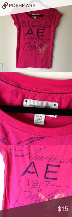 American Eagle short sleeve tee. AE fuchsia short sleeve tee. Front design has partial embroidery. Excellent condition. 20% off bundles of 2 or more! American Eagle Outfitters Tops Tees - Short Sleeve