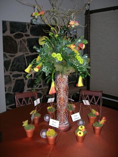 centerpiece on pedestal with copper linens