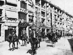 Japanese troops enter Hong Kong led by Lieutenant General Takashi Sakai and Vice Admiral Miimi Massichi.