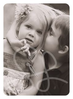 a boy...Whispering secrets to his girl (: