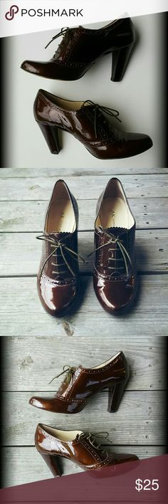Anne Klein Brown Lace Up Heels Anne Klein  Shiny Chocolate Brown Decorative Pumps   Great Condition  3.5 inch heel  Size 8  Any questions? Feel free to ask! Anne Klein Shoes Heels