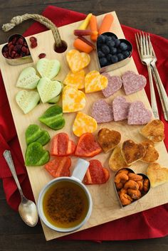 Valentine's Day Snack Board - Heart-shape all the things, for a girlfriend's Valentine's party, or a night in with your sweetie! | foxeslovelemons.com