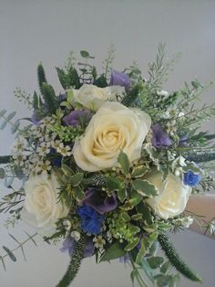 Avalanche roses, lilac lisianthus, white waxflower,  green bells and veronica, teamed with light variegated pittosporum