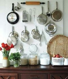 Design*Sponge at Home (Artisan Books) Creative Storage Straight from the hardware stores, sheets of pegboard create functional, yet chic storage space in a kitchen.