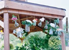 Hanging jars of flowers as ceremony decor   Laura Murray Photography   Bridal Musings   CHECK OUT MORE IDEAS AT WEDDINGPINS.NET   #weddings #weddingdecor #weddingdecoration #decor #decoration #events #forweddings