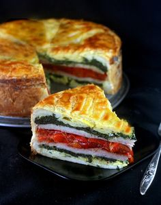 tourte Milanese - layers of herbed scrambled eggs, ham or turkey, garlic spinach, swiss cheese and roasted red peppers encased in puff pastry!  A great brunch stunner and easy!