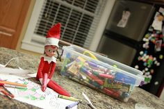 Elf on the Shelf Coloring Day  He got the boys' crayon bucket and was coloring Santa pics