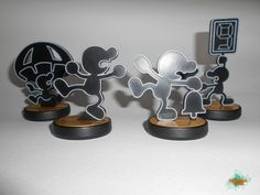 Plastic 1:1 Mr Game & Watch amiibo base replica ( 3 base set, no amiibo included) for display (no nfc chip). This item is not 3D printed. Automotive look a like paint with air-brush.  -Respawn Zone