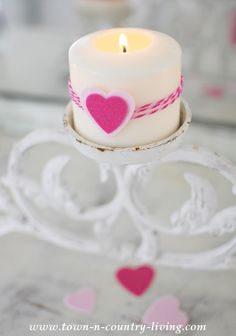 Wrap a candle with a few strands of baker's twine. Secure in place with a felt heart sticker. Easy Valentine's Day decorating!