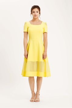 The Adare dress is back in this stunning yellow colour. Swing midi skirt with semi sheer check organza panel around the bottom, short sleeves and flattering square neckline. £139 #yellow #dress #summer #womenswear #ootd #edenrow