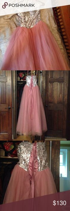 "Light pink long prom dress Long tulle and rhinestone prom dress. Worn once. Just to give a sizing indication I'm 5'2, wore 3"" heels(still a little long), waist 26 and bust 34. Also comes with an inner skirt to puff out the dress more. Dresses Prom"