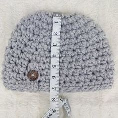 Try this easy 1 Hour Button Messy Bun Beanie to keep your head warm and your hair messy?! Free crochet messy bun hat pattern by Rescued Paw Designs. Like the cc messy bun beanie? Then you will love this simple messy bun beanie crochet pattern too!