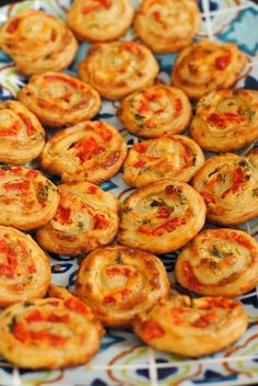 Red Pepper & Basil Pinwheels - A simple party appetizer made with puff pastry, roasted red peppers & basil. Can be served warm or at room temperature.