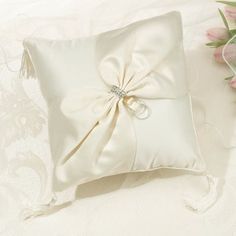 This elegant ring pillow is covered in ivory satin. An ivory satin sash is accented in the center of the pillow with a silver-plated rhinestone buckle and a pair of silver rings. Ivory tassels are found at all four corners of the pillow. Ring Bearer Pillows, Ring Pillows, Throw Pillows, Vintage Wedding Invitations, Printable Wedding Invitations, Wedding Stationery, Invitation Cards, Candle Wedding Favors, Wedding Gifts