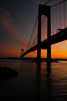 ✮ Sun setting behind the Verrazano Narrows Bridge in the Bay Ridge section of Brooklyn in New York City