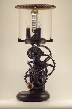 lamp made from old grinder and clock parts, runs off both plug-in electricity and hand-crank power