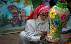 Pakistani artist Habib-ur-Rehman paints traditional art on a vase at his stall during a Punjab Culture Festival in Islamabad, Pakistan on Sunday. The festival showcases rich culture, arts, crafts, folk music and cultural traditions of the most populous province of the country.