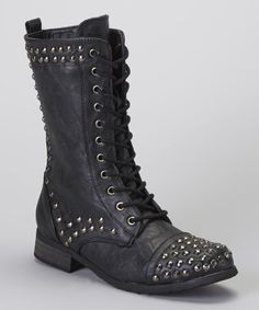 Undeniably edgy, these lace-up boots sport the perfect amount of tough-girl glam. Flaunting metallic studs and a versatile short shape, this pair is sure to add stomp-worthy prowess to any ensemble. 1.25'' heel9.5'' shaft11'' circumference