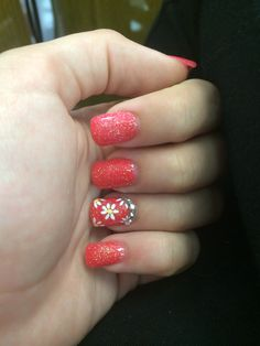 Pink and coral sparkly acrylic powder gel nails with summertime daisies and rhinestones
