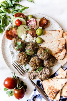 These tender Mediterranean Meatballs are served with our favorite simple tzatziki sauce and make for a delicious and unexpected weeknight dinner. Falafels, Mediterranean Couscous, Mediterranean Meals, Greek Dishes, Main Dishes, Tzatziki Sauce, Thing 1, Beef Recipes, Yummy Recipes