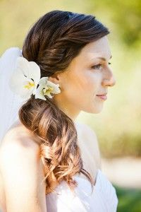 I like the pulled to the side and curled look.