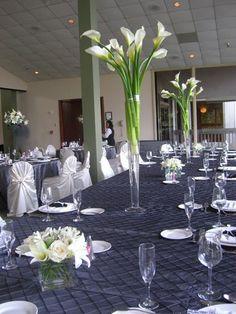 tall table arrangement. white calla lilies. simple wedding flowers. flower centerpiece. Head table flowers. http://thebloomingidea.blogspot.com
