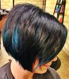 blue peekaboo highlights on dark hair | Inverted bob. Peekaboo blue streaks.