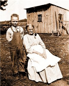 Women with corncob pipe and grandson. 1870s
