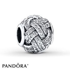 Double rows of sterling silver lined with sparkling clear cubic zirconias weave a love knot in this charm from the PANDORA Mother's Day 2015 collection. Exclusively available at Jared®, the Galleria of Jewelry. Style # 791537CZ.