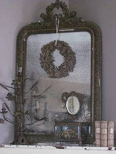 Gorgeous detail at the top of this French mirror..