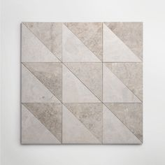 Inspired by the architecture of New York, the new Gramercy Park collection offers a versatile range of marble slab, tiles and décors. It includes contemporary marble tiles in eye-catching geometric patterns alongside plain honed surfaces. Available in a palette of 3 colourways – ivory, soft grey and veined black, the collection is designed as a suite of surfaces to be used in combination or individually. Slab options, ideal for skirtings, architraves, vanities and shower trays also available. Grey Marble Tile, Gramercy Park, Architrave, Ivory, Contemporary, Stone, Antiques, Geometric Patterns, Shower Trays