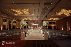 Chicago Wedding Photographer: Nakai Photography - Hindu wedding ceremony room photo! Wedding Ceremony Venue: Hyatt Regency OHare. Coordinator: Oliveaire Artisan Events and Meetings. White flowers http://www.nakaiphotography.com