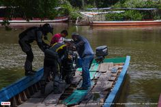 The Great World Trek, getting their bikes on to 'Pangas' to get them down the river in Guatemala