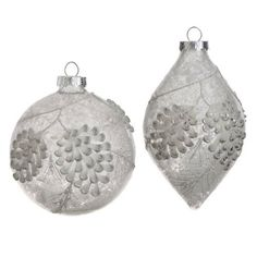 Antiqued Pinecone Ornament, by Raz Imports. Silver/white glass ornament with antiqued finish, and raised pinecone detail. Part of the Forest Frost Collection. Measures 4 or 3.5 x 5.5 inches. Made of g