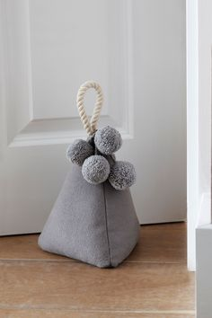 This doorstop has been designed with pom pom detailing and rope handle, so it's super easy to move from room to room. Sponge clean only. Doorstop Pattern Free, Diy Doorstop, Diy Sewing Projects, Sewing Crafts, Porte Diy, Fabric Door Stop, Fabric Fish, Sewing Toys, Diy And Crafts
