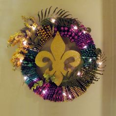 How cool is this Mardi Gras wreath? It's made with beads thrown off floats from past parades. Mardi Gras Wreath, Mardi Gras Beads, Mardi Gras Parade, Good Times Roll, Crescent City, Stuff And Thangs, Wreath Ideas, Holidays And Events, Holiday Crafts