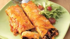 Pull together these cheesy, easy meatless enchiladas with the help of a few and Old El Paso pantry standards. Black beans, corn and green chilies lend colorful Mexican flavor.
