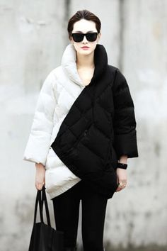 Black + White Down Coat // I love this coat! for something that's quilted its actually quite slimming due to the unusual color blocking design technique #wearabledesign