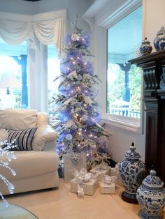 Snow flocked Christmas tree with lavender ribbon.