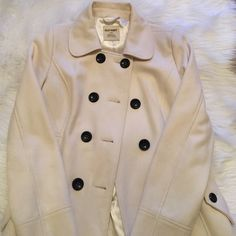 Old Navy Coat Cute cream Old Navy coat with black buttons. Looks adorable on! Old Navy Jackets & Coats