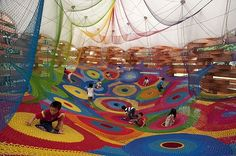 Rainbow Nest - Japan  This is just one area of the Takino Hillside Park outside Sapporo. The rainbow nest by crochet artist Toshiko Horiuchi-MacAdam allows kids to climb into a unique environment and turn their world literally upside down.    Image Credit Playground Designs