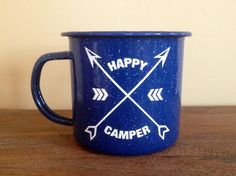 You are looking at a 12 oz enamel mug with my custom Happy Camper design on the front made from a glossy high-quality permanent vinyl rated for outdoor use.  My mugs only come in blue, but your design can be in any of the colors shown in my color chart (last image). White vinyl is shown in the sample images. Choose your colors at checkout!  ENAMEL MUG HOLDS 12 FLUID OUNCES!  This personalized mug make a great gift! Engagements, birthdays, anniversaries, stocking stuffers, etc! Perfect for…